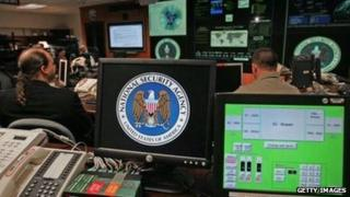 Employees sit at their stations at the NSA's Threat Operations Center.