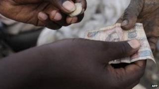 People passing money in Kenya