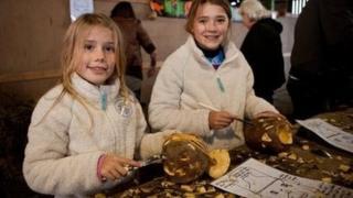 Emily Jones, 11 and Lizzie Jones, nine, carving their Turnips at Cregneash