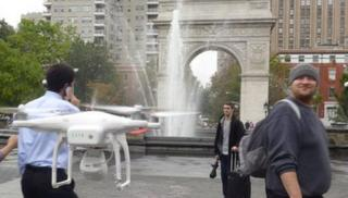 Man drone and Washington square park arch