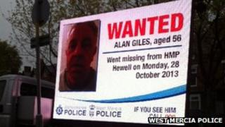 TV van displaying image of Alan Giles