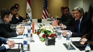US Secretary of State John Kerry (C-R) and members of his delegation meet with Egypt's Foreign Affairs Minister Nabi Fahmy (C-L) and other Egyptian officials during Mr Kerry's visit to Egypt on 3 November 2013 at the Fairmont Hotel in Cairo