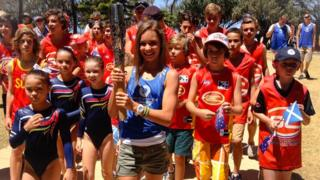 Some of the young Gold Coast residents who enjoyed the visit of the baton.