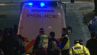 Police officers and van