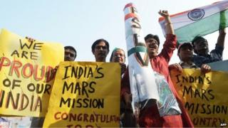 Indians celebrate the launch of the Mars Orbiter Mission in Calcutta on November 5, 2013.