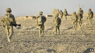 Soldiers from the 1st Battalion Royal Regiment Fusiliers return to their base, Sterga 2, after conducting a successful dawn foot patrol in the Nahr-e Saraj district, Helmand Province, Afghanistan.