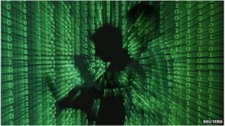 Digital image of man holding laptop