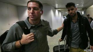 Glenn Greenwald (left) and his partner David Miranda at Rio airport