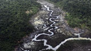 A creek devastated as a result of oil spills in the Niger Delta on 22 March 2013