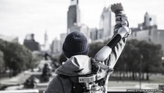 Man wearing Titan Arm raised aloft