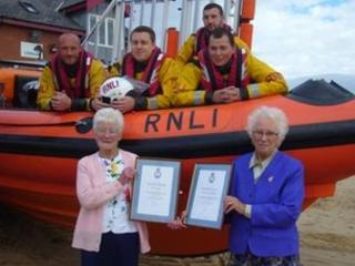 Jen Taylor and Kathy Blackman with RNLI crew