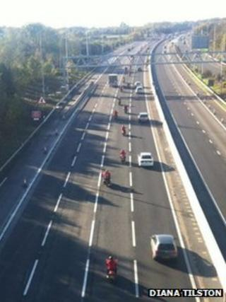 Bikers in red on the M25 on Remembrance Sunday