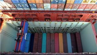 Containers being unloaded in the port of Hamburg, Germany