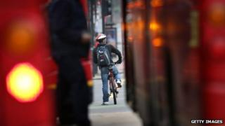 Cyclist between two buses in London