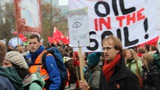 Protesters marching in Warsaw demanded rapid action on climate change
