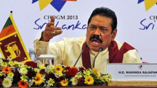Sri Lankan President Mahinda Rajapaksa gestures as he answers during a media briefing on the final day of the Commonwealth Heads of Governments Meeting (Chogm) in Colombo