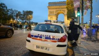 French police officers patrol on the Champs Elysees in Paris