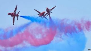 The RAF Red Arrows perform ahead of the Royal International Air Tattoo