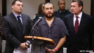 George Zimmerman (C), the acquitted shooter in the death of Trayvon Martin, answers questions from a Seminole circuit judge during a first-appearance hearing on charges including aggravated assault stemming from a fight with his girlfriend in Sanford, Florida 19 November 2013