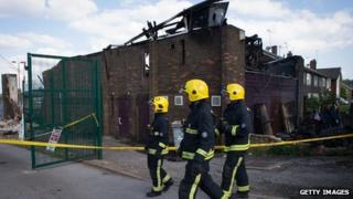 Fire officers survey the fire damaged Bravanese Centre in Muswell Hill London