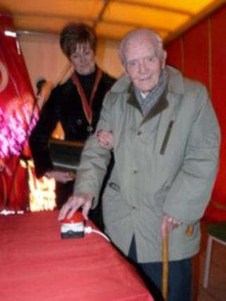 Hugh Lloyd Jones switches on Llanfairfechan Christmas lights in 2013