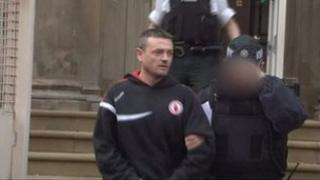 Gavin Coney being escorted from court after an earlier appearance
