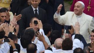 Pope Francis greets a crowd in the Vatican on November 24