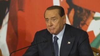 Italian Senator Silvio Berlusconi speaks at a press conference in Rome on 25 November.