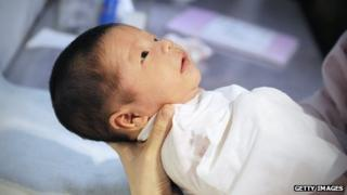 A baby wrapped in towel at a Beijing hospital