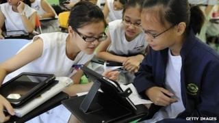 Pupils in Singapore with tablet computers