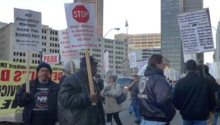 Protestors holding signs outside Detroit courthouse