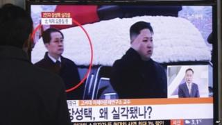 A man watches a TV news programme showing North Korean leader Kim Jong-un (R) and Chang Song-taek at Seoul Railway Station in Seoul, South Korea, on 3 December 2013