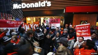 Fast food workers protest against McDonald's in New York on 5 December 2013