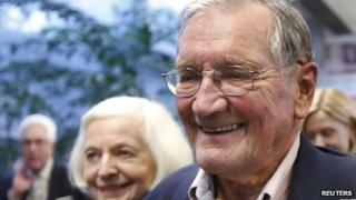 Merrill Newman smiles after being reunited with his wife, Alicia, at San Francisco International Airport.