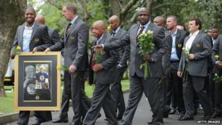 Members of the Kaizer Chiefs football team arrive at Nelson Mandela's home in Houghton, Johannesburg, to pay tribute. 9 Dec
