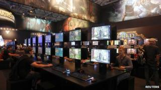 Visitors play World of Warcraft in Cologne, Germany on 21 August 2013