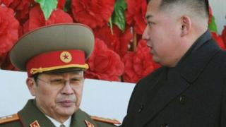 North Korean leader Kim Jong-un (R), walks past his uncle North Korean politician Jang Song-thaek, during a military parade to mark the birth anniversary of the late leader, Kim Jong-il in Pyongyang, in this file photo taken by Kyodo February 16, 2012.