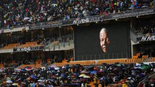 Nelson Mandela's image projected on a big screen in the FNB stadium in Soweto