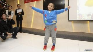 Guo Bin, 6, attends his farewell party