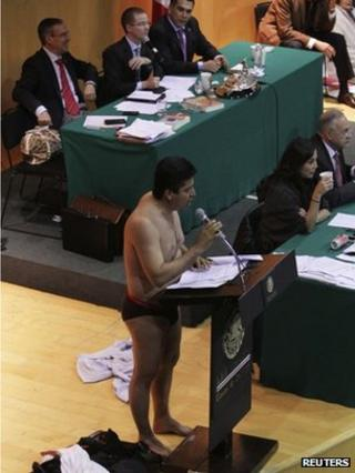 Opposition MP Antonio Garcia strips down to his underwear in Congress