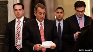 US Speaker of the House John Boehner (second from left) walked to the House Chamber on 12 December 2013