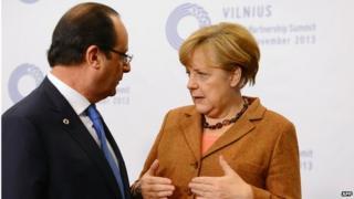 French President Francois Hollande with German Chancellor Angela Merkel at the Vilnius EU summit, 29 November