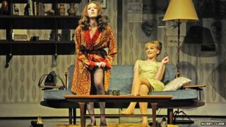 Christine Keeler (Charlotte Spencer) and Mandy Rice Davies (Charlotte Blackledge) in Stephen Ward. Photo by Nobby Clark