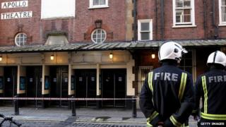 Firefighters stood outside the Apollo