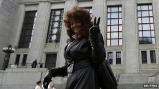 Terri-Jean Bedford gestures while leaving the Supreme Court of Canada following a hearing on the country's prostitution laws, in Ottawa on 13 June 2013