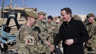 David Cameron shakes hands with a soldier in Afghanistan