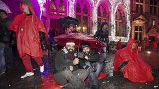 People take part in a protest camp in Mons