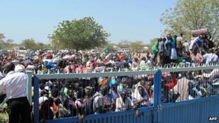 A handout photo from UNMISS shows civilians gathering outside the UNMISS compound in Bor, on December 18