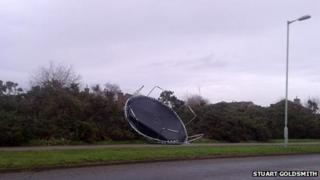 Trampoline blown across the road