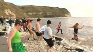 People taking part in the Boxing Day dip at Flamborough